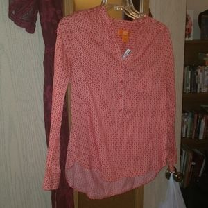 Coral and white patterned blouse